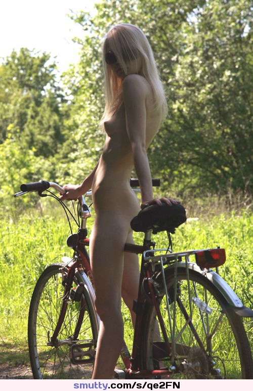 naked football girl plays outdoors and squirts a bit